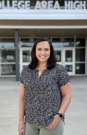 Mrs. Elisabeth James poses in front of State High for a professional portrait. James joined the Office of Equity and Inclusivity as the State College Area School District's first-ever mental health clinician for the 2021-2022 school year.
