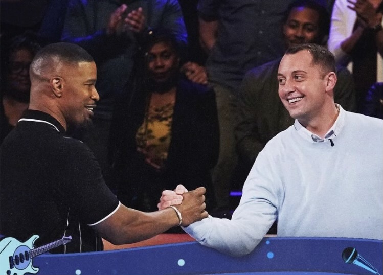 Alex Raup shaking hands with Beat Shazam host, Jamie Foxx. Raup was a contestant on Beat Shazam on Aug. 18, 2021.