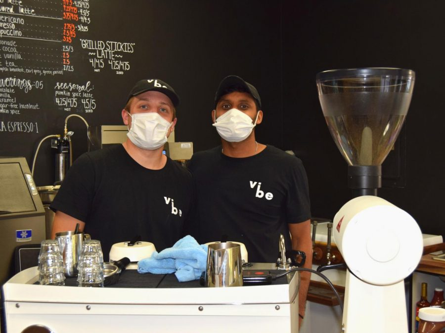Vibe Coffee Co. co-founders Ethan Steiger (left) and Tameel Noel (right) pose behind the counter of their bustling coffee shop on Sept. 24. Located at 401 W. Beaver Avenue, Vibe Coffee Co. is the latest addition to State College's coffee scene.