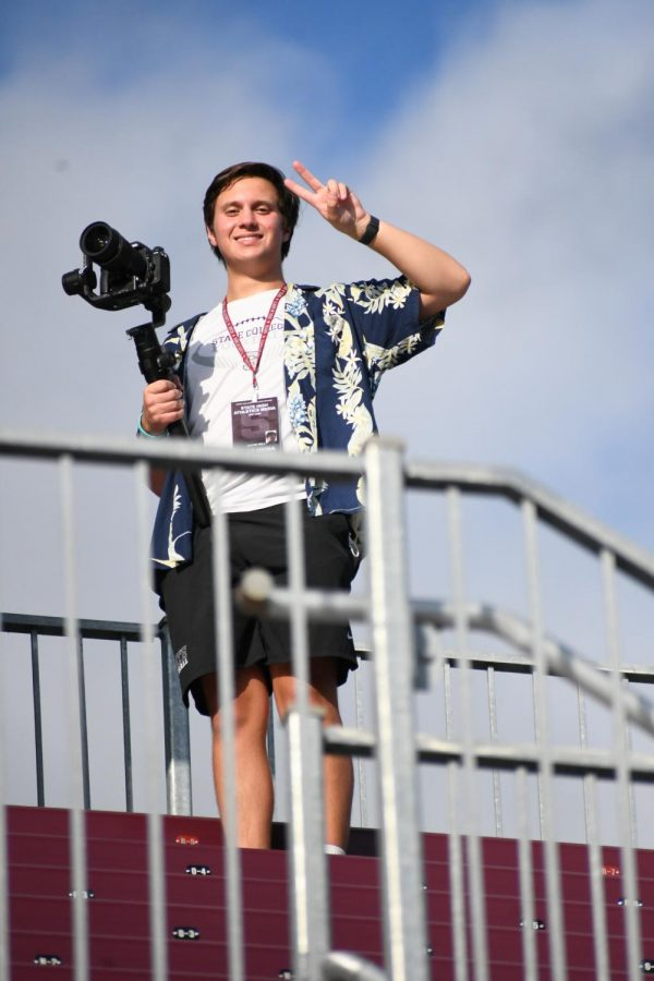 Jacob Will poses on the bleachers at Memorial Field with his camera on Hawaiian night. September 3rd, 2021.